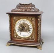 A German ornately carved and brass mounted mantel clock, height 34cm