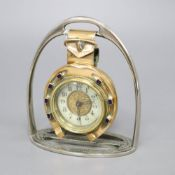 A late Victorian British United Clock Company brass and enamel 'horseshoe' desk timepiece with