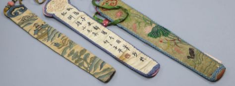 Three embroidered Chinese fan cases, one Kesi and woven with a tree, river and temple motifs,