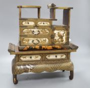 A Japanese Meiji lacquer table cabinet and similar stand, overall height 37.5cm