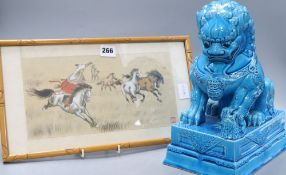A turquoise glazed dog of fo, height 37cm and a silkwork
