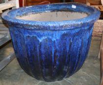 A large blue glazed garden planter, 80cm diameter
