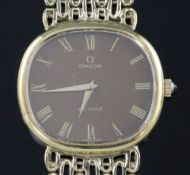 A gentleman's 1970's silver gilt Omega de Ville manual wind wristwatch, on Omega oval link bracelet,