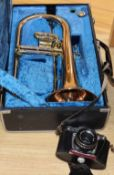 A Yamaha trumpet and a cased camera