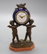 A French porcelain and bronze putti mantel clock, with diamonte decoration to the dial, height 20cm