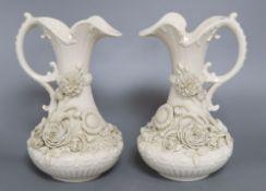 A pair of Belleek ewers, second period, height 23cm