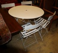 A painted metal circular folding garden table, 97cm diameter, H.72cm and four folding chairs