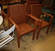 A set of six stained teak garden elbow chair