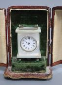An early 20th century white metal mounted mother of pearl miniature timepiece, marked to base