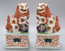 A pair of Japanese models of shi-shi, height 25cmCONDITION: The upper corner of the base closest