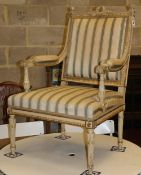 A late 19th / early 20th century French parcel gilt elbow chair