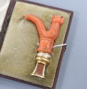 A cased 19th century yellow metal mounted jasper seal with coral handle carved as a dragon (tail