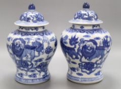 A pair of Chinese blue and white 'dragon' vases, height 26cmCONDITION: We believe these to be modern
