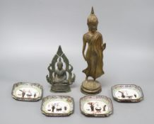 A 19th century bronze Thai standing figure, a Thai bronze seated figure and four Canton enamel