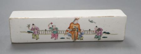 A Chinese famille rose scroll weight, length 21cm
