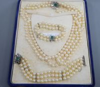 A triple strand cultured pearl necklace and matching bracelet with white metal, emerald and
