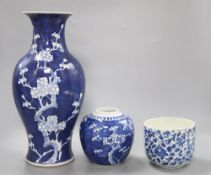 A Chinese blue and white 'prunus' vase, height 36.5cm, jar and a kangxi blue and white jar (