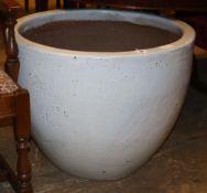 A large white glazed circular garden planter, 70cm diameter, H.55cm