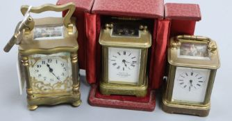 A cased lacquered brass miniature carriage timepiece and two others