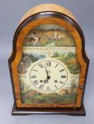 A Victorian style maple mantel clock