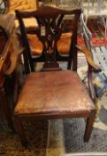 Two George III mahogany elbow chairs