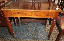 A Victorian Gillows-style walnut two drawer writing table, W.92cm, D.51cm, H.74cm
