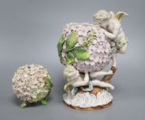 A German centrepiece, height 22cm and a small vase