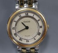 A lady's modern stainless steel and yellow metal Gucci quartz wrist watch, with original receipt and
