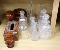 A quantity of cut glass decanters and treen