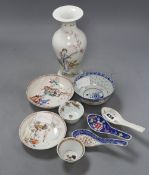 Two 18th century Chinese famille rose tea bowls and two saucers, together with three rice spoons and