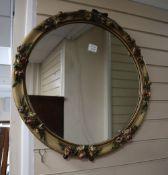 A circular floral moulded mirror, 68cm diameter