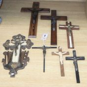 Seven 19th century and later cut metal and composition Corpus Christi, longest 40cm