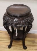A Japanese lacquered wood stand, Meiji period, 52cm diameter, H.76cm