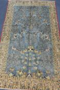 A Qum carpet, 254 x 156cmCONDITION: Slightly faded with wear to blue ground, no rips or tears