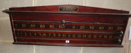 An early 20th century mahogany wall hanging snooker scoreboard by Mortloch, London, W.106m, H.38cm