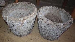A pair of circular reconstituted stone brick effect garden planters, 28cm diameter, H.24cm
