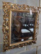 A Florentine style carved giltwood wall mirror (a.f.), W.60cm, H.66cm