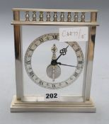 A Jaeger Le Coultre chrome plated skeleton timepiece, height 19cm