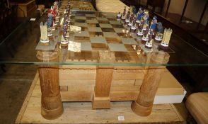 A Heritage Tables jigsaw chess table, modelled on Bodiam Castle with chequer glass top and a set