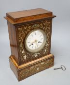 A 19th century French inlaid rosewood cased eight day mantel clock, with brass, mother of pearl