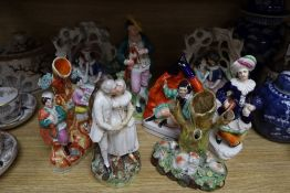 Eight Staffordshire pottery figures and groups