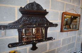 A Victorian inlaid rosewood overmantel mirror, W.84cm, together with a later Flemish carved oak