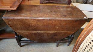 An 18th century oak gateleg table, W.120cm, D.142cm extended, H.74cm