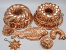 Seven 19th century copper jelly moulds