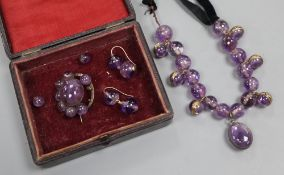 A Victorian amethyst bead and black sash necklace, (quartz section 21cm) and a similar brooch and