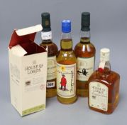 A bottle of House of Lords whisky signed by Margaret Thatcher and three other autographed bottles.