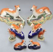 Eight various Staffordshire pottery greyhounds, tallest 16cm