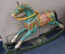 An Indian painted carved hardwood rocking horse, L.160cm, H.104cm