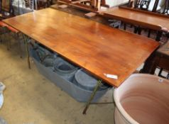 A vintage stained oak and wrought iron trestle table, W.177cm, D.86cm, H.72cm