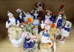 A Staffordshire pottery King Charles spaniel and seven various pottery figures and groups (8)